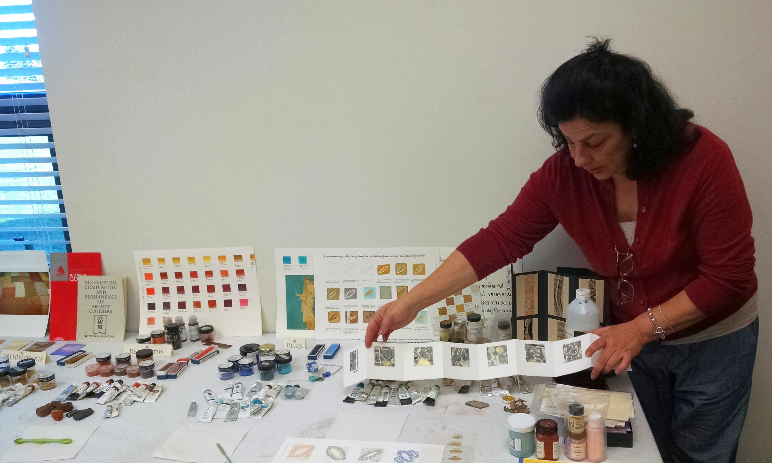 Georgia Angelopoulos showing examples of pigments and gold leaf