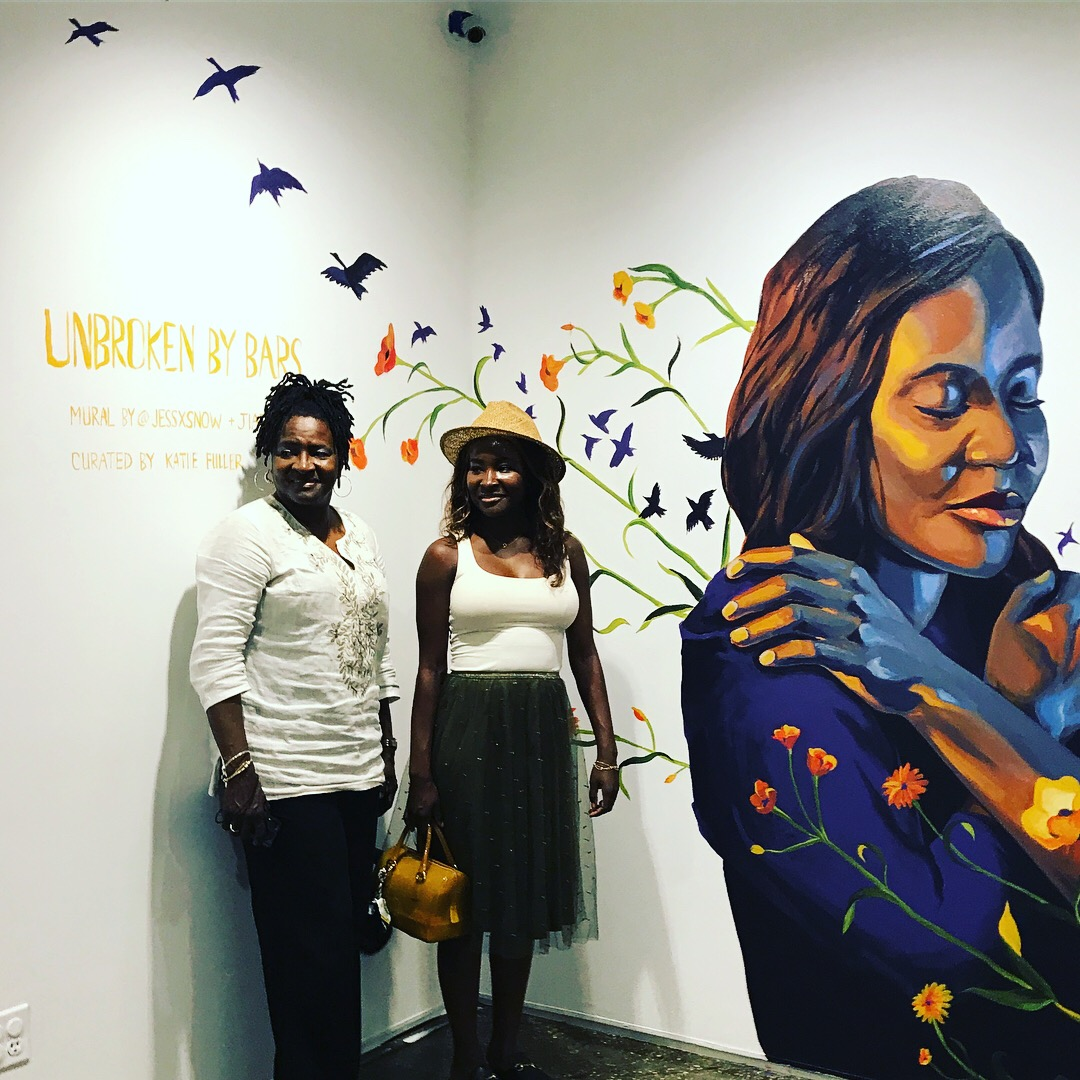Carole Eady-Porcher and Jahmil Eady in front of a mural by Jess X Snow, A.I.R. Gallery, Brooklyn