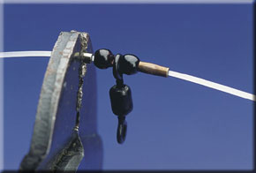 4. Position the 45lb swivels with beads and crimps either side along the length of the rig body and secure in place by lightly crushing the crimps with crimping pliers. Pinched lightly they can be adjusted to suit hook snood positions.