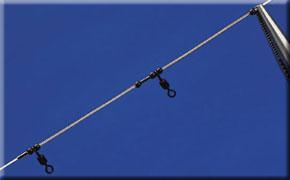 2.Now thread on a crimp, bead, 45lb swivel, bead, SRT spring, bead, crimp, bead, swivel, SRT spring and finally another bead.