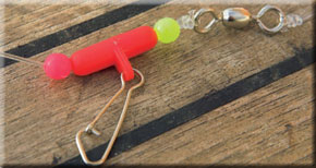 4. Cut the your hooklength to about 18 inches and tie a 100lb test swivel on the end. Thread a bead, zip slider and bead on your mainline and tie to the swivel