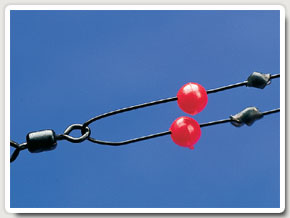 2.  Beads and stop knots will prevent the hooks becoming jammed in the snood swivel if a fish takes one of the hooks