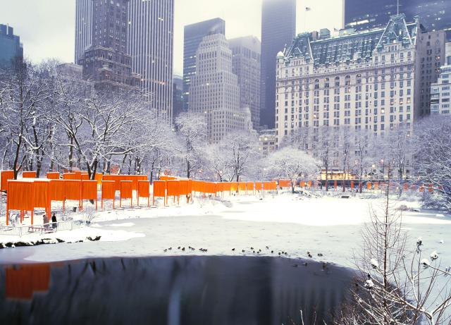 "CHRISTO. ""The installation of The Gates in New York's Central Park was completed in February 2005. The 7,503 gates with their free-hanging saffron colored fabric panels seemed like a golden river appearing and disappearing through the bare branches of the trees"". Christo & Jean-Claude. Color Production by Colibri Textile Dyeing Studio."