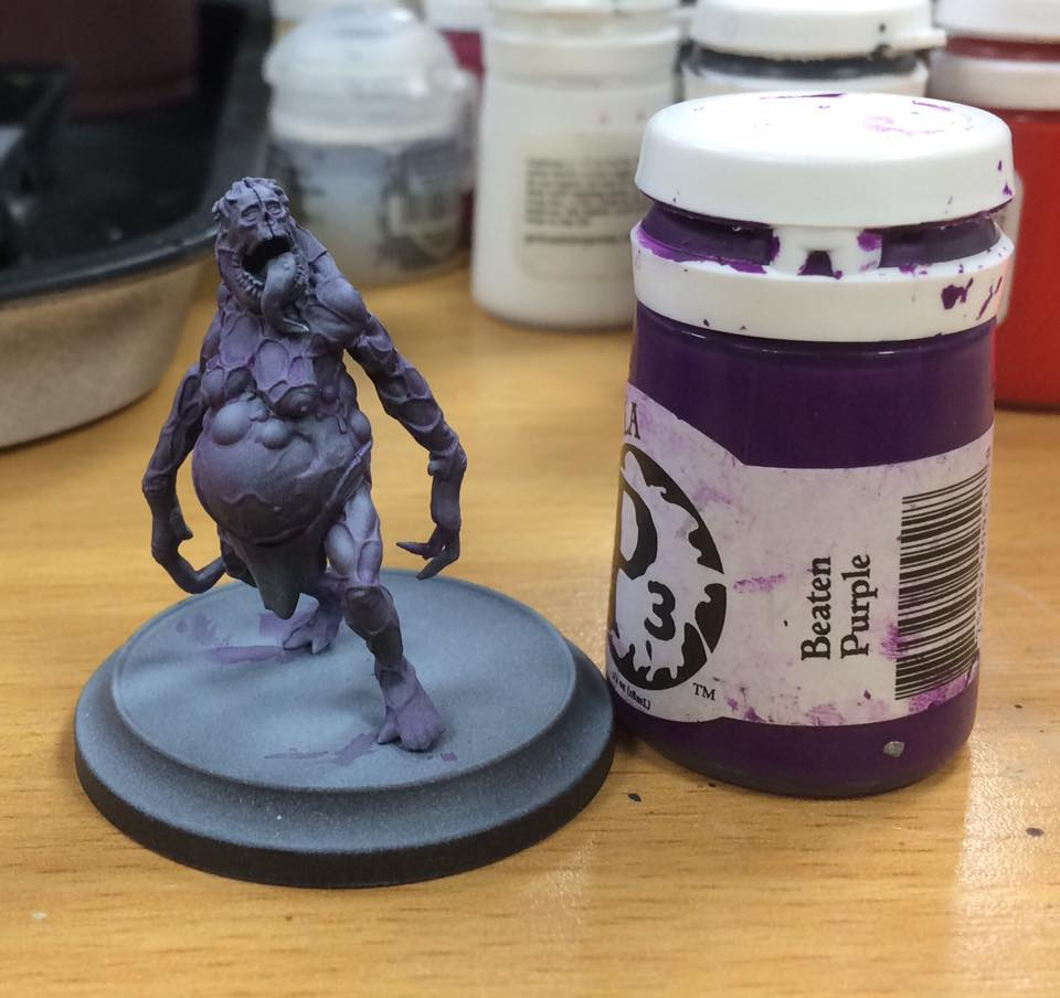 A shade of beaten purple is laid over the model. I water the paint down 3-1 to achieve this. You can change the final look of the model by going on with a different colour at this stage. A green wash will make the model look more rotten, a red wash will make it look more sore… experiment and have fun!