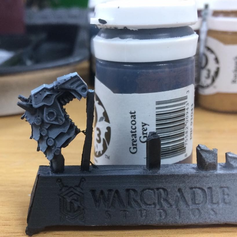 Over a black undercoat lay down a basecoat of Greatcoat Grey. I water this down around 4-1 and feather out the edges into the shadows.