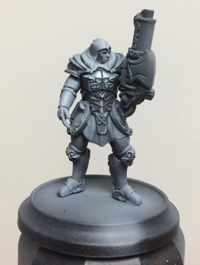A glaze (90% water 10% paint) of Cygnar Base Blue is applied to tone the monochrome work so far. You can change this tone to suit the metal effect you're aiming for. Blue gives a nice steel effect.