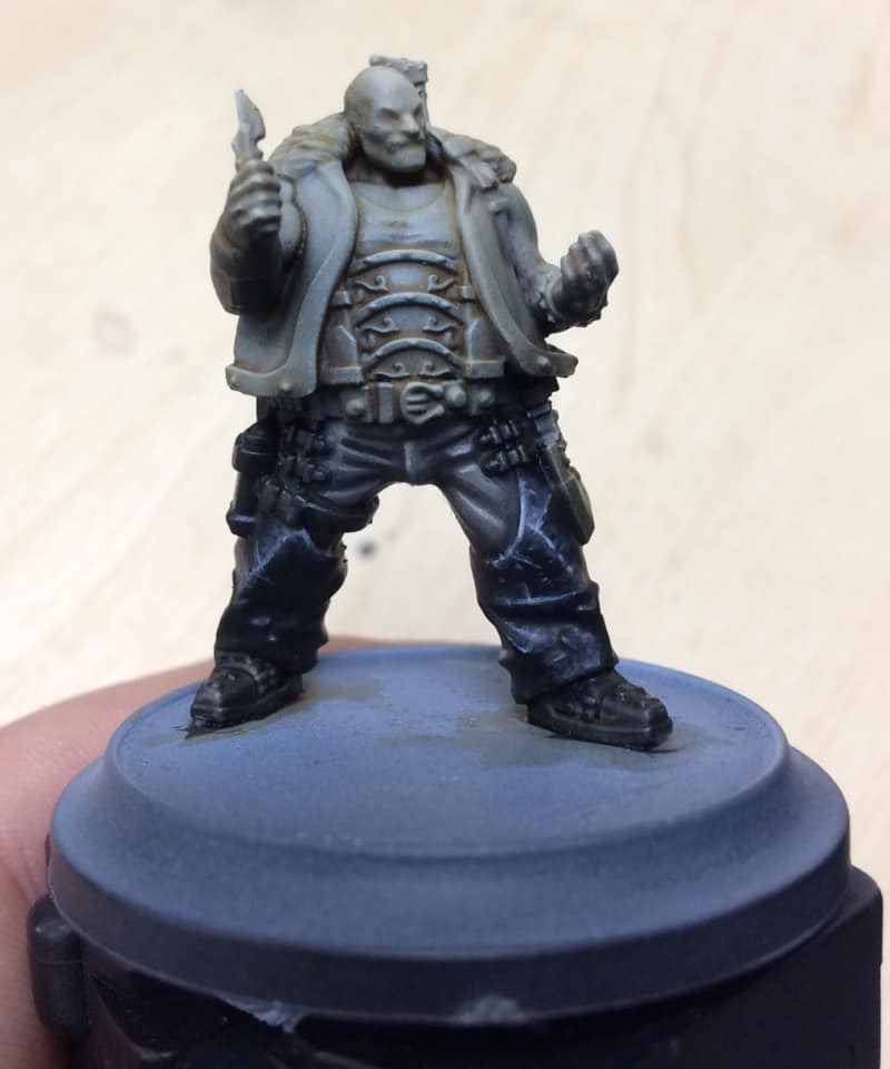 Step 5 - the folds and scratches are picked out in pure Menoth White Highlight with our 000 brush.