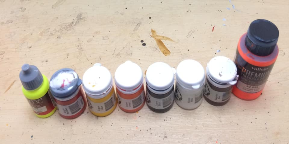 Paint Comparison: Fluro Yellow, Primary Red, Primary Yellow, Rich Orange, Black, White, Burgundy and Fluro Orange