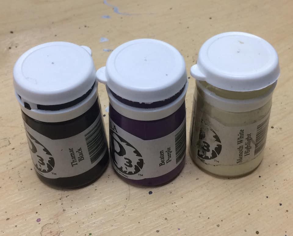 Colour comparison: Black, rich purple, pale bone.