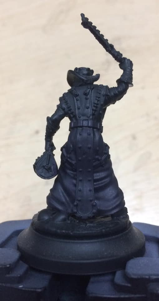 The robe was base coated in a 1:1:2 mix of Thamar Black, Beaten Purple and water.