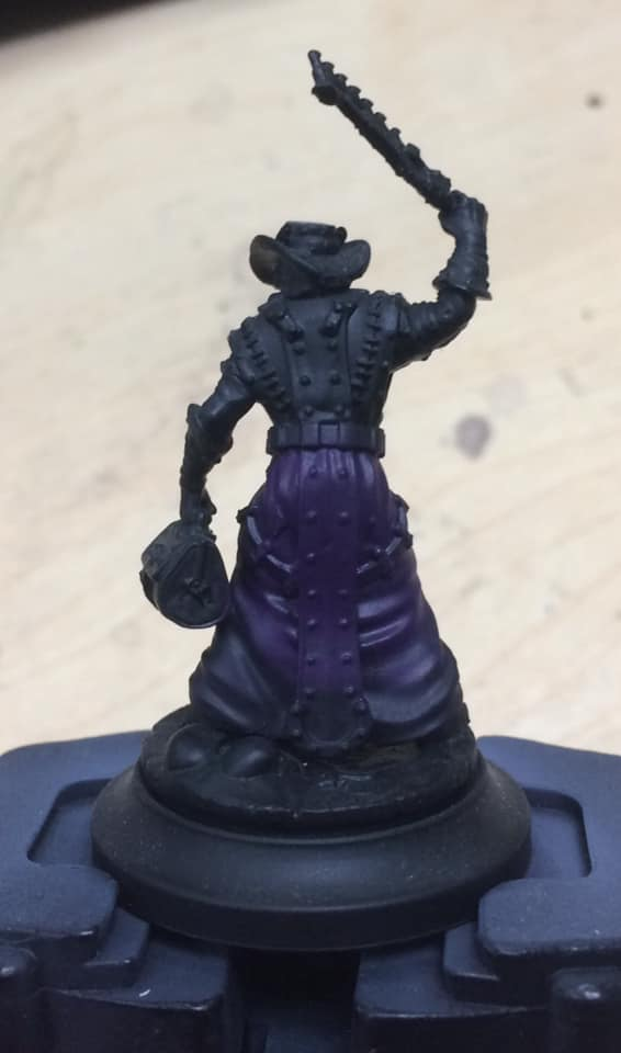 Starting a quarter of the way up the model a coat of 1:2 Beaten Purple and water was applied to the entire area.