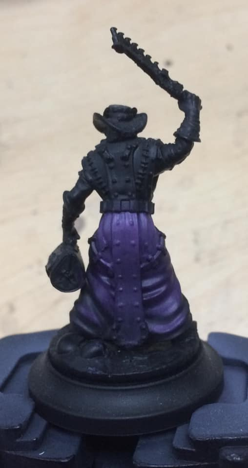 Starting three quarters of the way up the robes the area was painted 1:1:2 Beaten Purple, Menoth White Base and water.