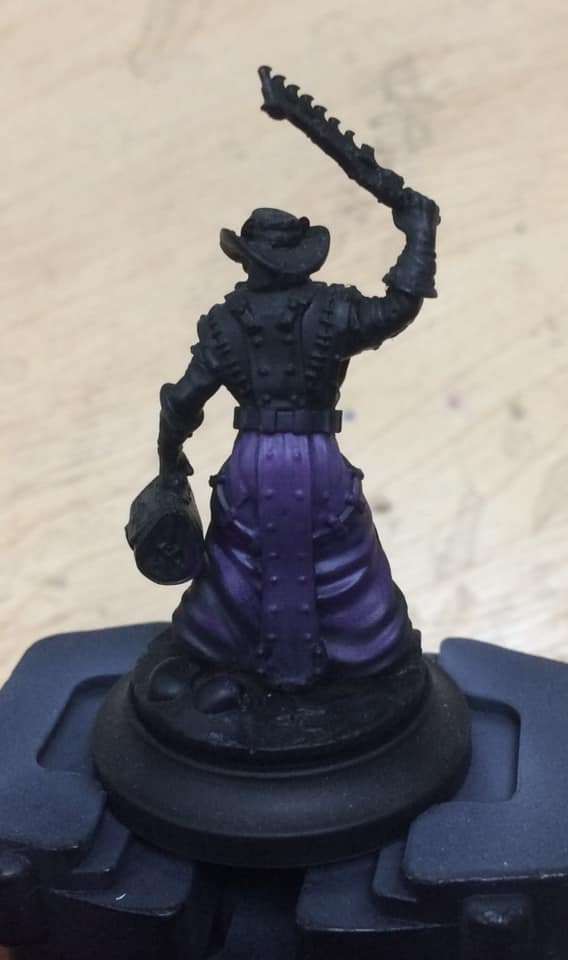 On to highlighting - the bottom quarter of the robes was highlighted with Beaten Purple