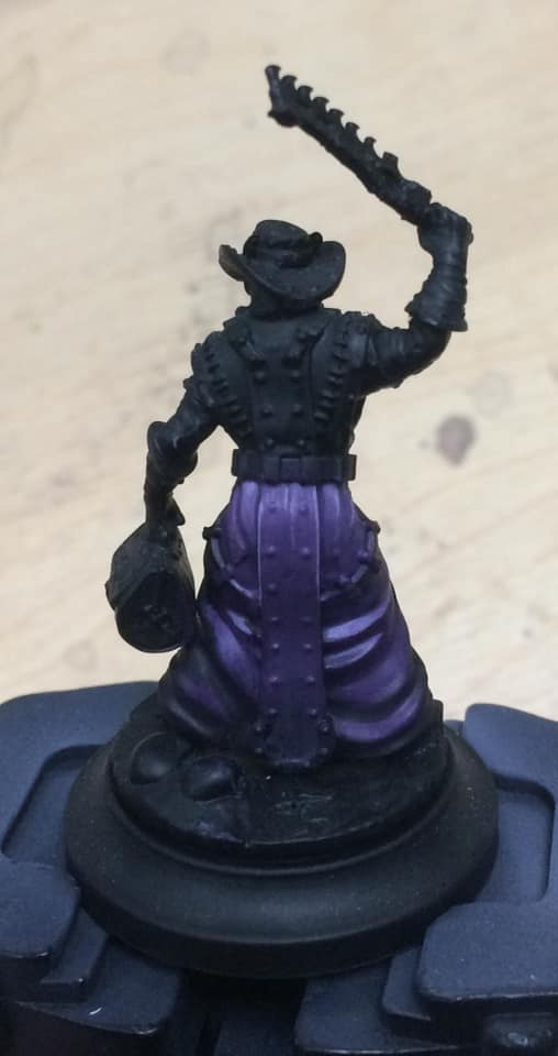 The fourth and final quarter at the top of the robes was highlighted with 1:2:2 Beaten Purple, Menoth White Base and water. This was also applied to any sharp edges.