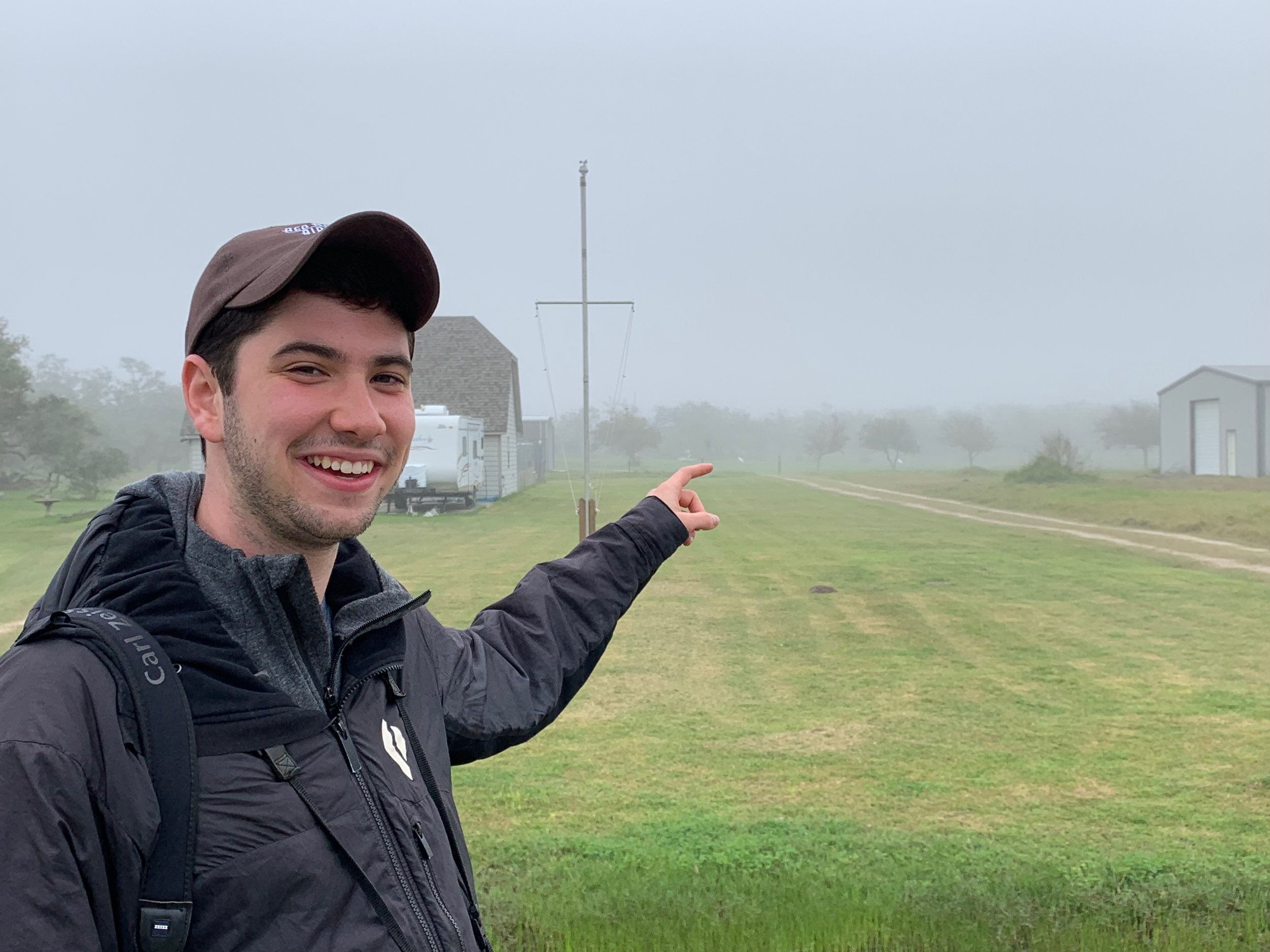 Nathan pointing to his 650th bird in the Lower 48, a Whooping Crane