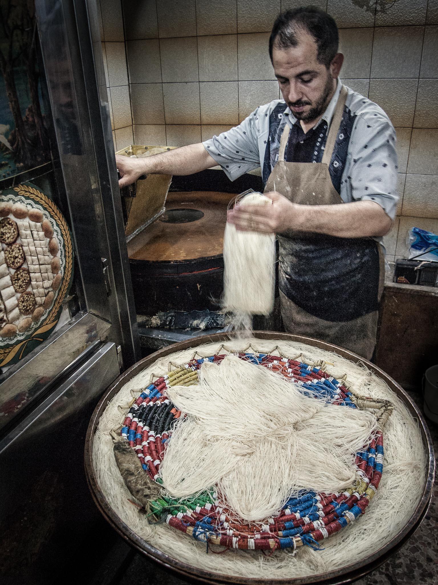 Stringy, sweat baklava in the making (Aleppo)