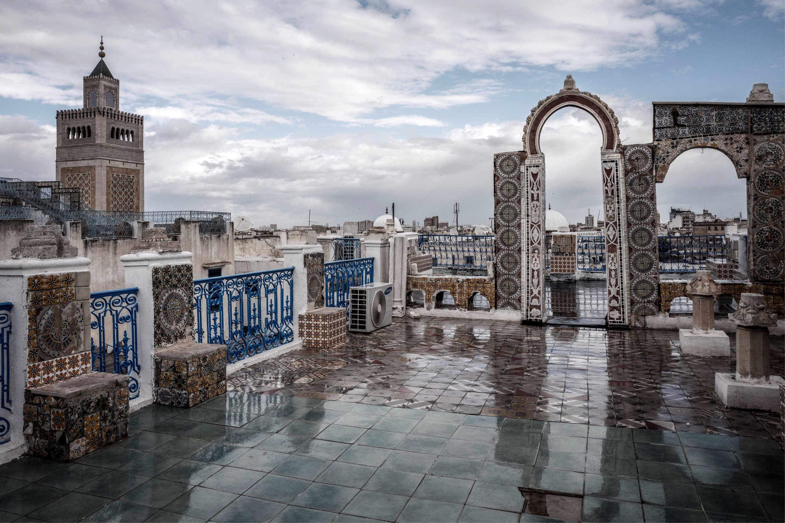 A rooftop view over the Medina de Tunis, dominated by the 1895 minaret of Zitouna Mosque, while the mosque itself dates from the 8th century.