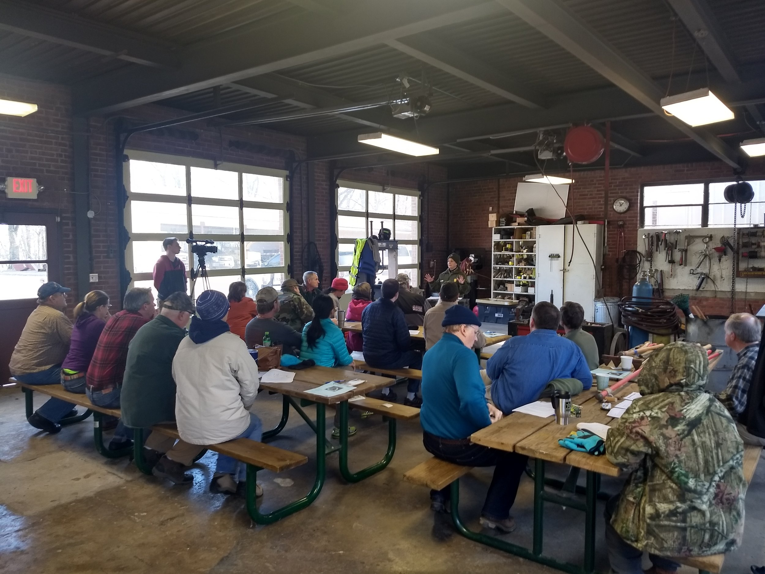 NPS employee teaching volunteers during the classroom portion of the volunteer training (on a cold January morning!)