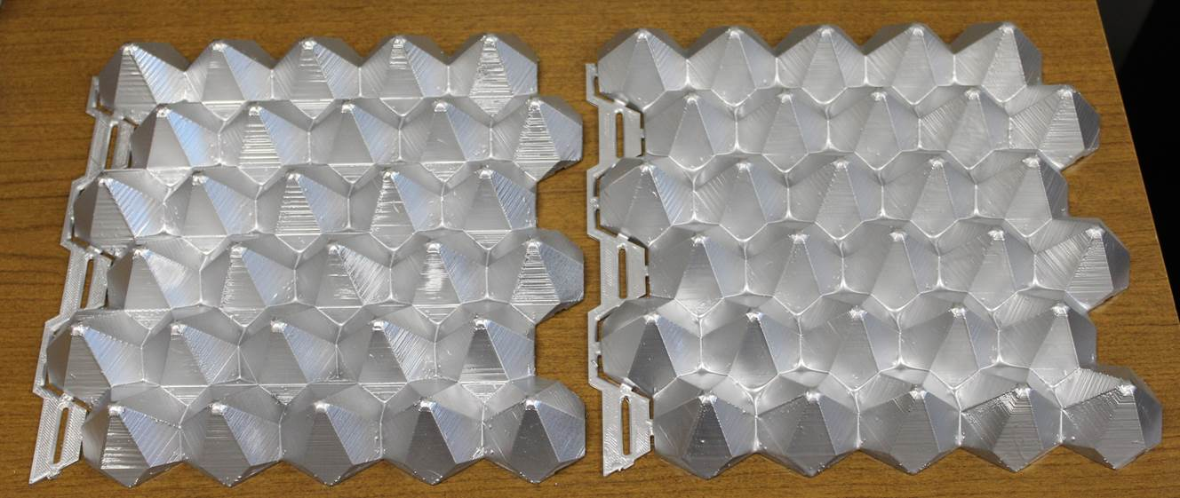 Figure 1. Prototype architectural tiles created using an equilateral triangle truncating object with a 60 °  truncation rotation