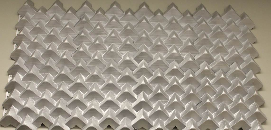 Figure 3. 4 x 2 array of 3D architectural tiles created using an equilateral triangle truncating object with a 30 °  truncation rotation