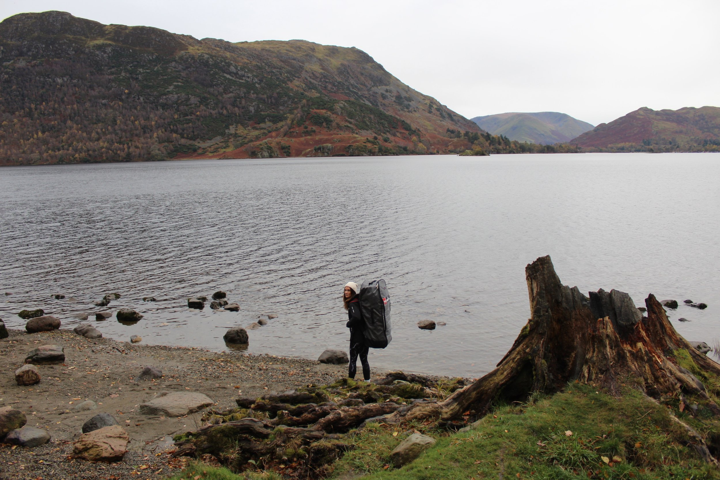 Hiking down to Ullswater with my paddle board (can you see the little island in the distance?)