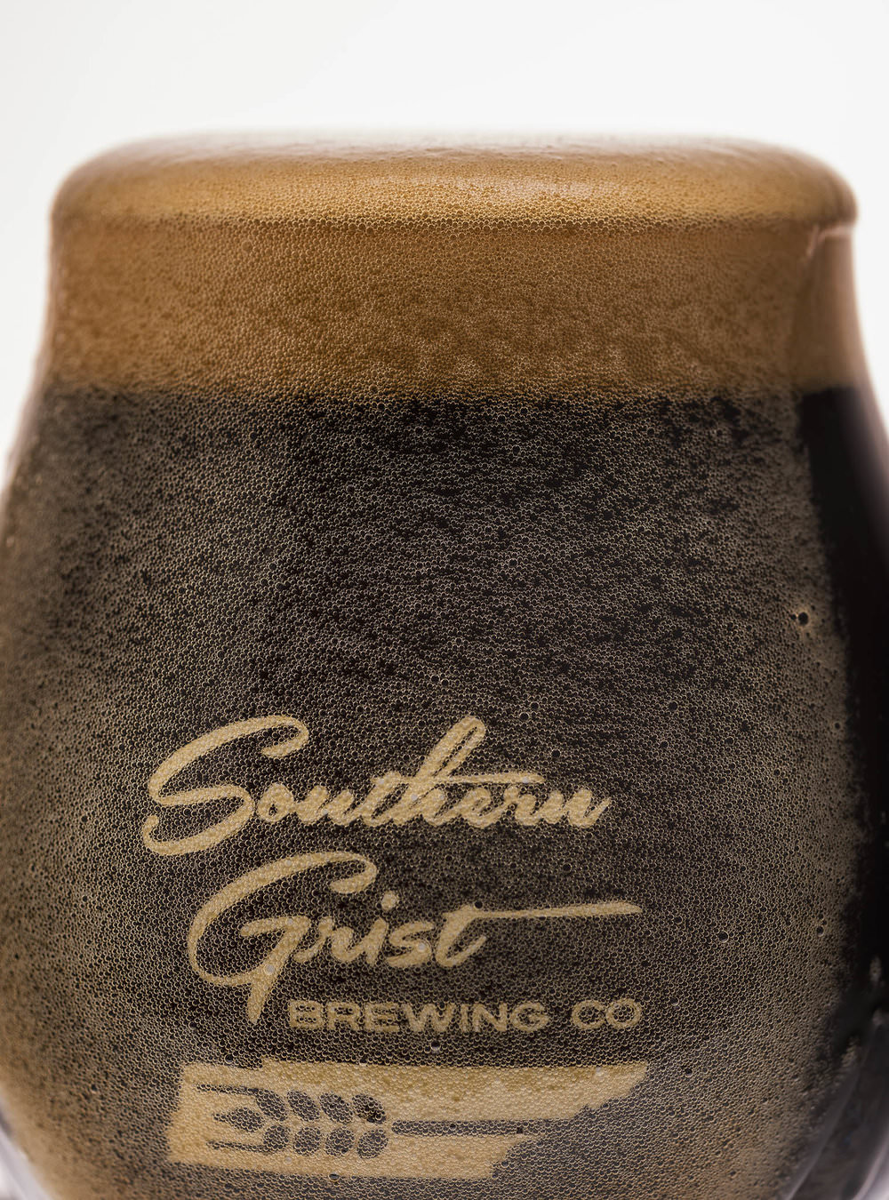 Southern Grist beer with the head overflowing