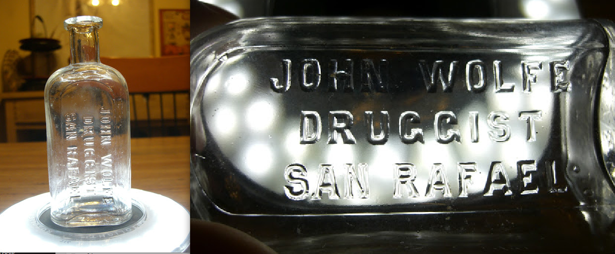 "Bottle inscribed ""John Wolfe Druggist San Rafael"" (Yona Edell)"