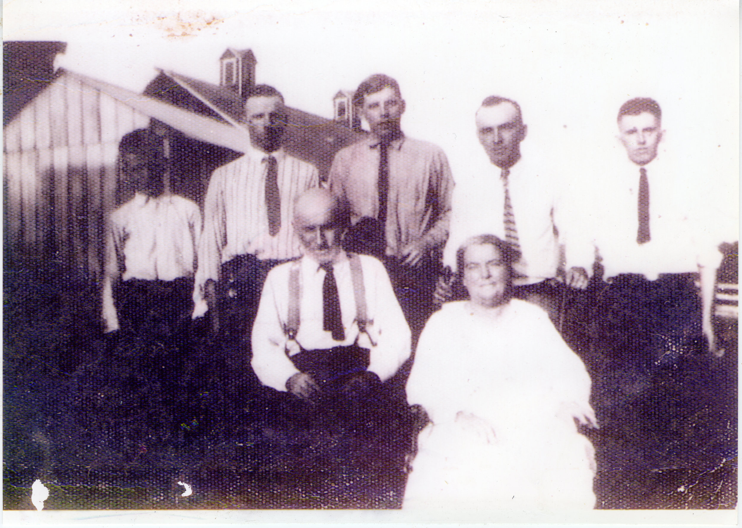 The Wolfe family, ca. 1923 (left to right: James Emmet Wolfe, Philip James Wolfe, Maurice Buckley Wolfe, John J. Wolfe, Sarah McAndrews Wolfe, Raymond Bernard Wolfe, and Melvin Wolfe)
