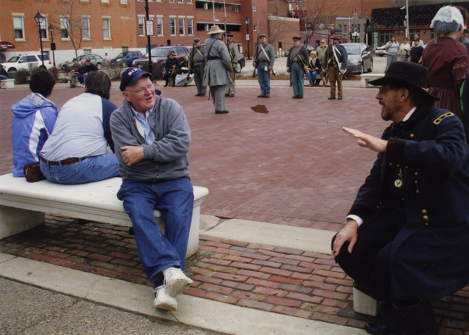 Tom Wolfe talking to a historical reenactor, Galena, Illinois; undated