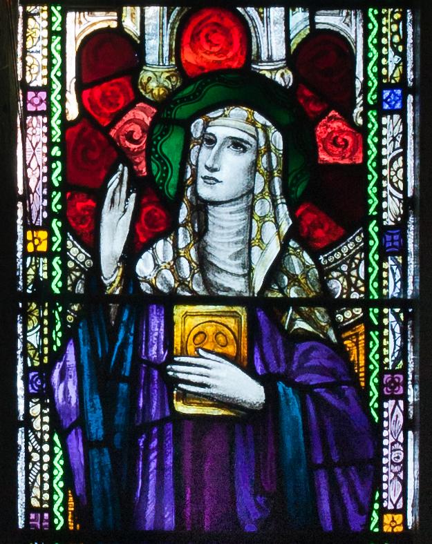 Stained glass window of Íte in Saint Kieran's Church,  Ballylooby  (  Wikipedia  )