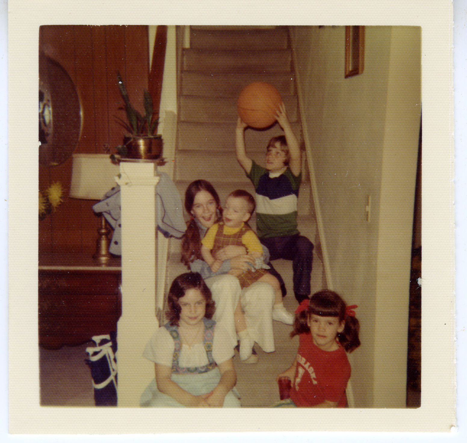 From bottom left and clockwise: Kate Wissing, Beth Wissing,  Brendan Wolfe , John Wissing, and Bridget Wolfe, at the Wissing home in Davenport