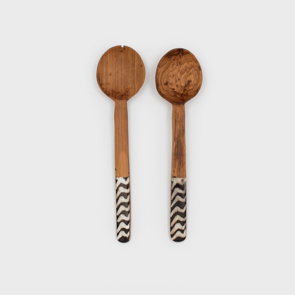 Perfect for your world traveling friend. Olive wood and bone salad servers from Kenya $38