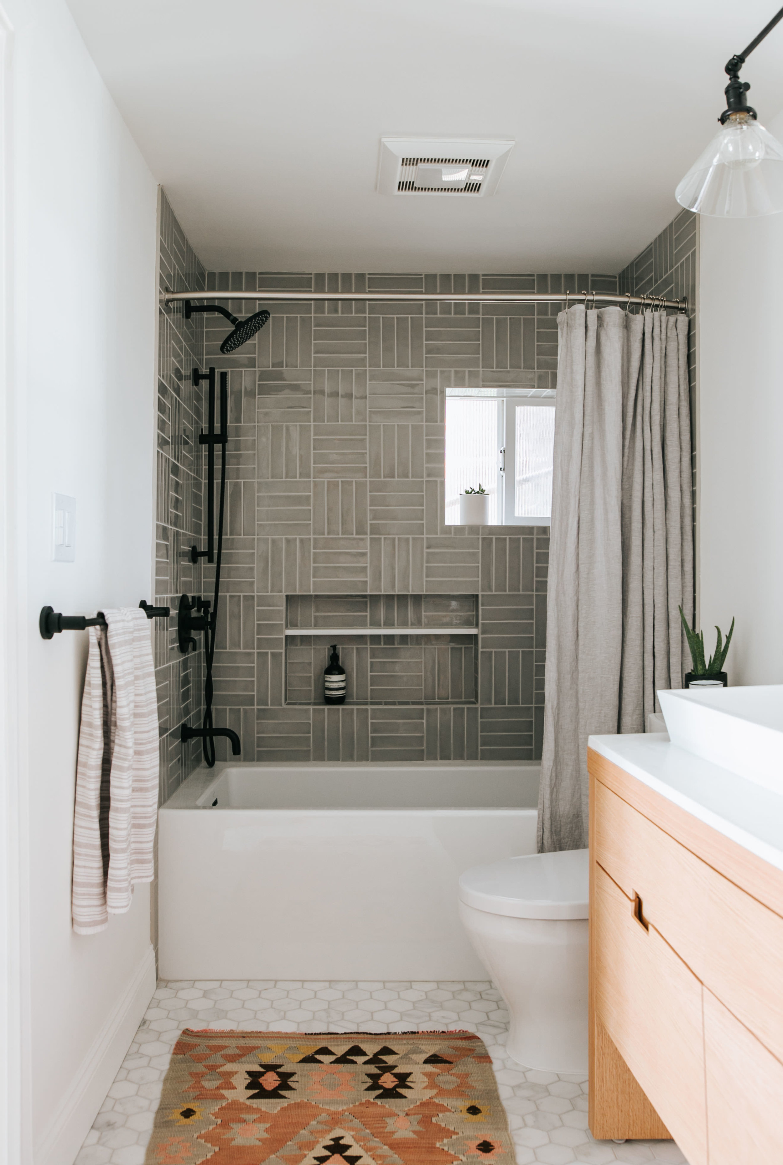Love the marble shelf we added to the niche for smaller shower goods (and to keep razors out of reach of bathing kids!)