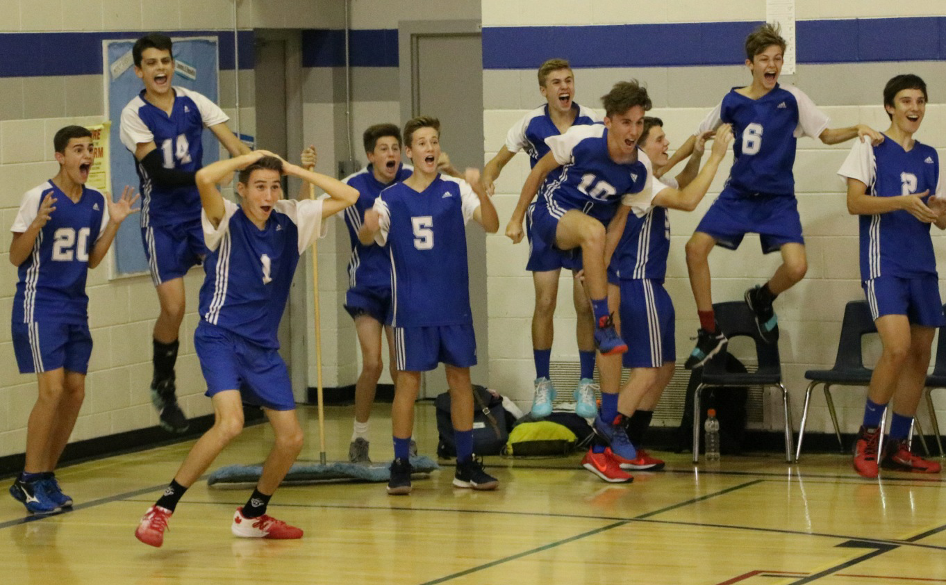 Junior Boys Volleyball team celebrating a point during a home league game!
