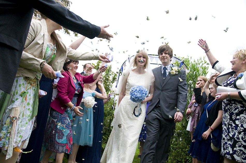The confetti throwing shots are always prone to a bit of projectile mishappery – often the best you can hope for is that nobody gets blinded!  In this particular case Vicky the bride has apparently had a very fetching blue and green moustache grafted onto her face. Looks itchy!