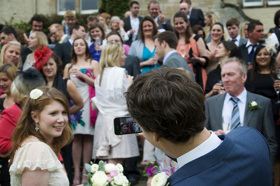 You may struggle to see the comedy value of the above pic. The action was actually happening behind the lens this time. Having assembled the entire wedding party on the steps at Duntreath Castle (Amazing venue!) for the big group shot, I crouched down to see what the angle looked like…..and was greeted by a loud ripping sound coming from behind me. Yes, there's no better time to split your trousers  right up the back  than when you're trying to look like the consummate professional in front of a hundred people. To add insult to injury I'd chosen brightly coloured pants that day.  At least I didn't have to try very hard to get them laughing for the photo…….