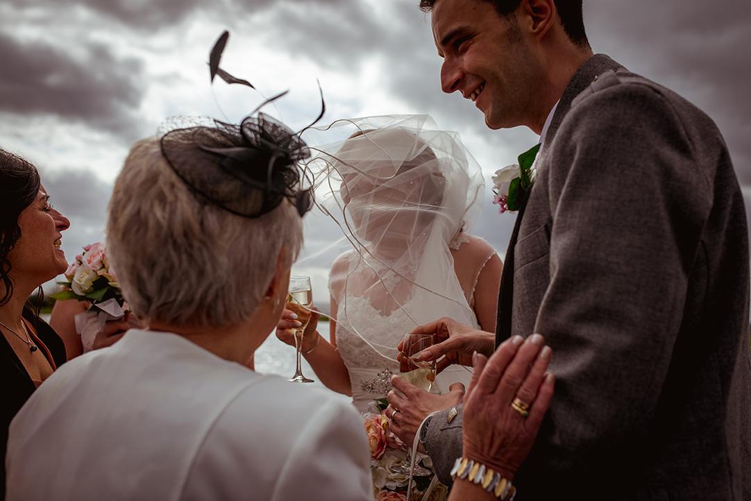 funny wedding photography glasgow windy weather