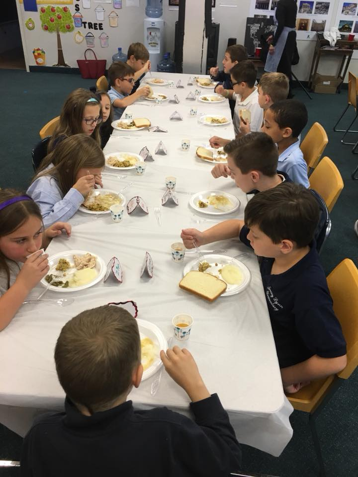 Table manners and properly setting the table is practiced during the annual homemade Thanksgiving feast