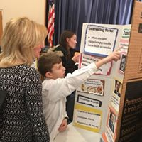 Students practice public speaking skills for their Global Fair Night