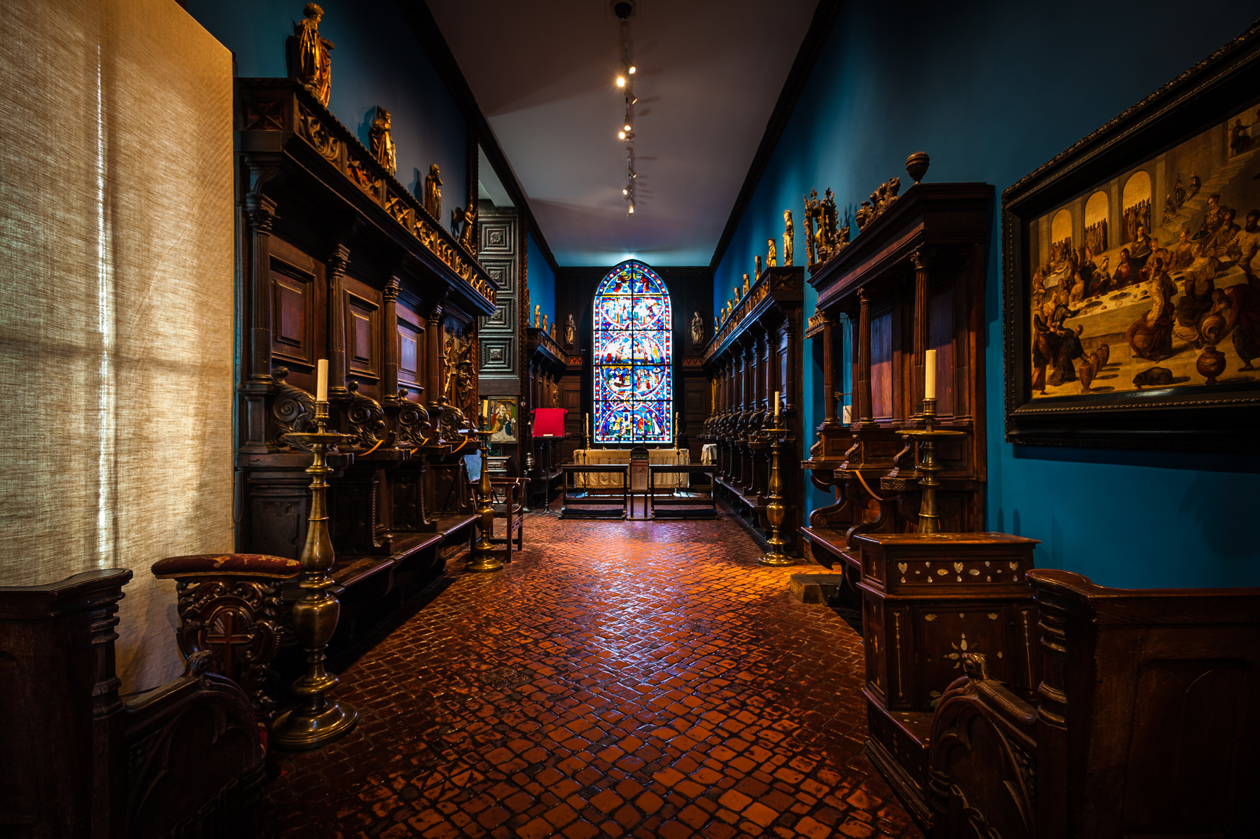 "- The focal point of the chapel at the Isabella Stewart Gardner Museum is a twelve-foot high stained glass window ""Scenes from the Lives of Saint Nicasius and Saint Eutropia,"" created in France in the early thirteenth century."