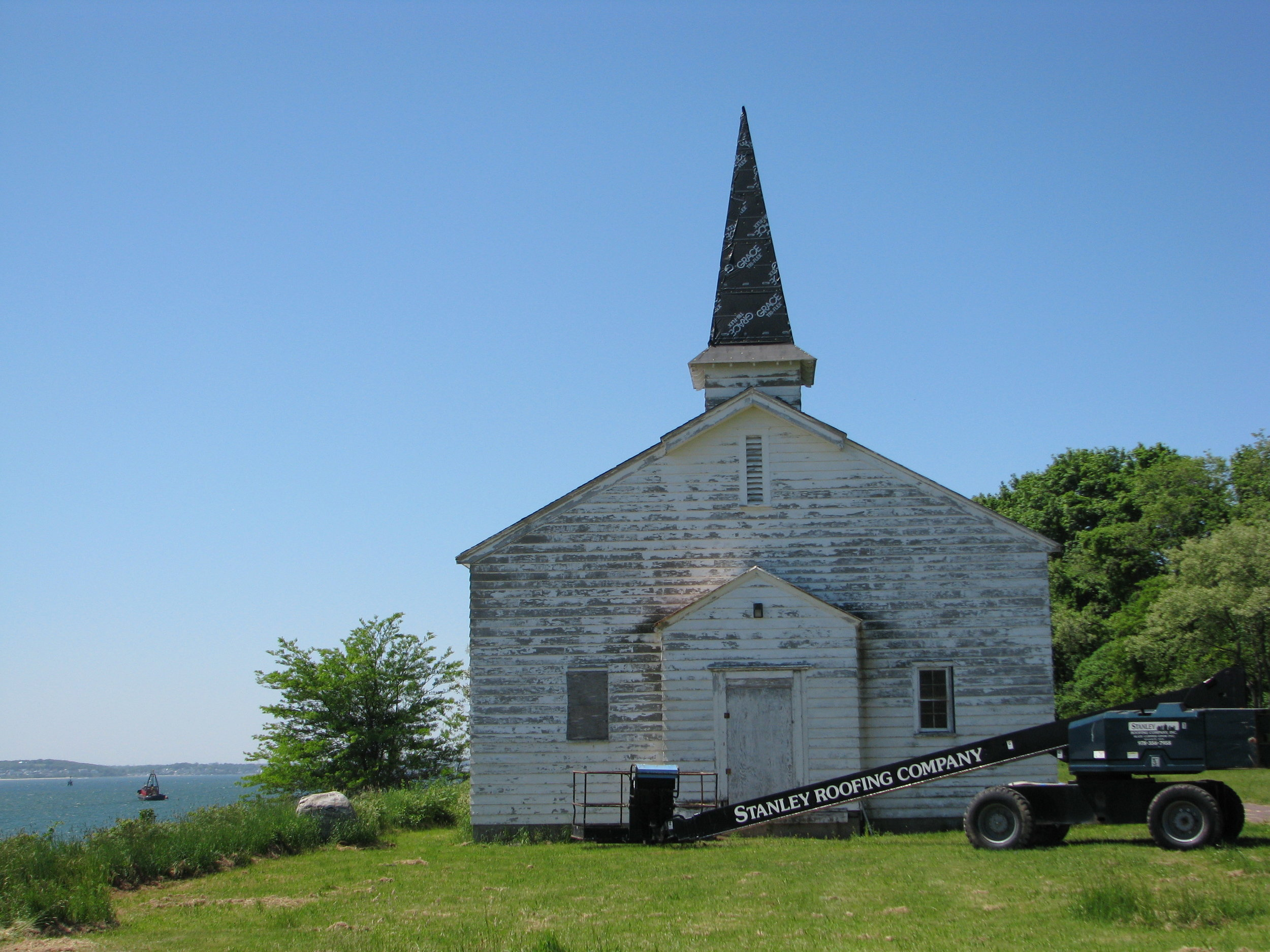 PT-3d. Chapel entrance view_damaged windows, faded paint (2013).JPG