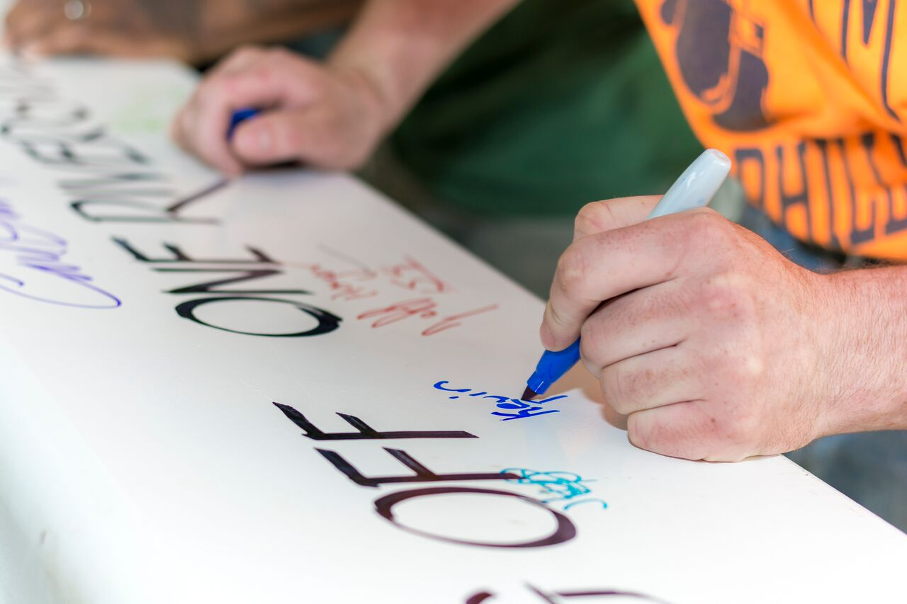 signing banner