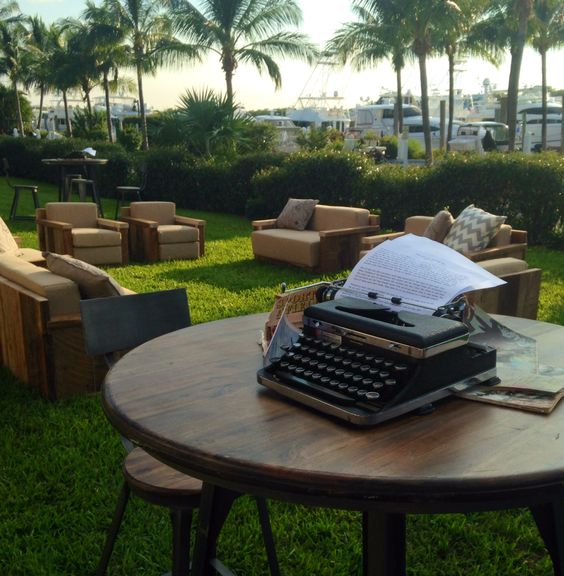 typewriter on table outside with palm trees