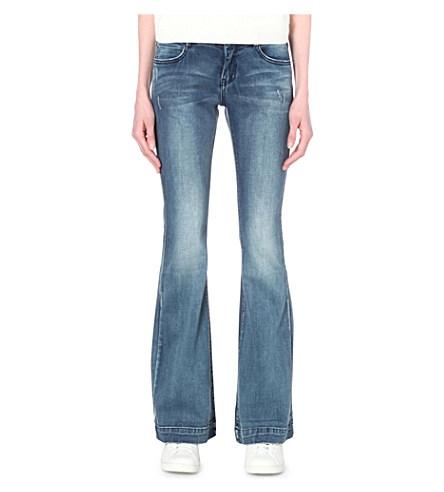 MOCo-Distressed-FLared-Jeans.jpeg