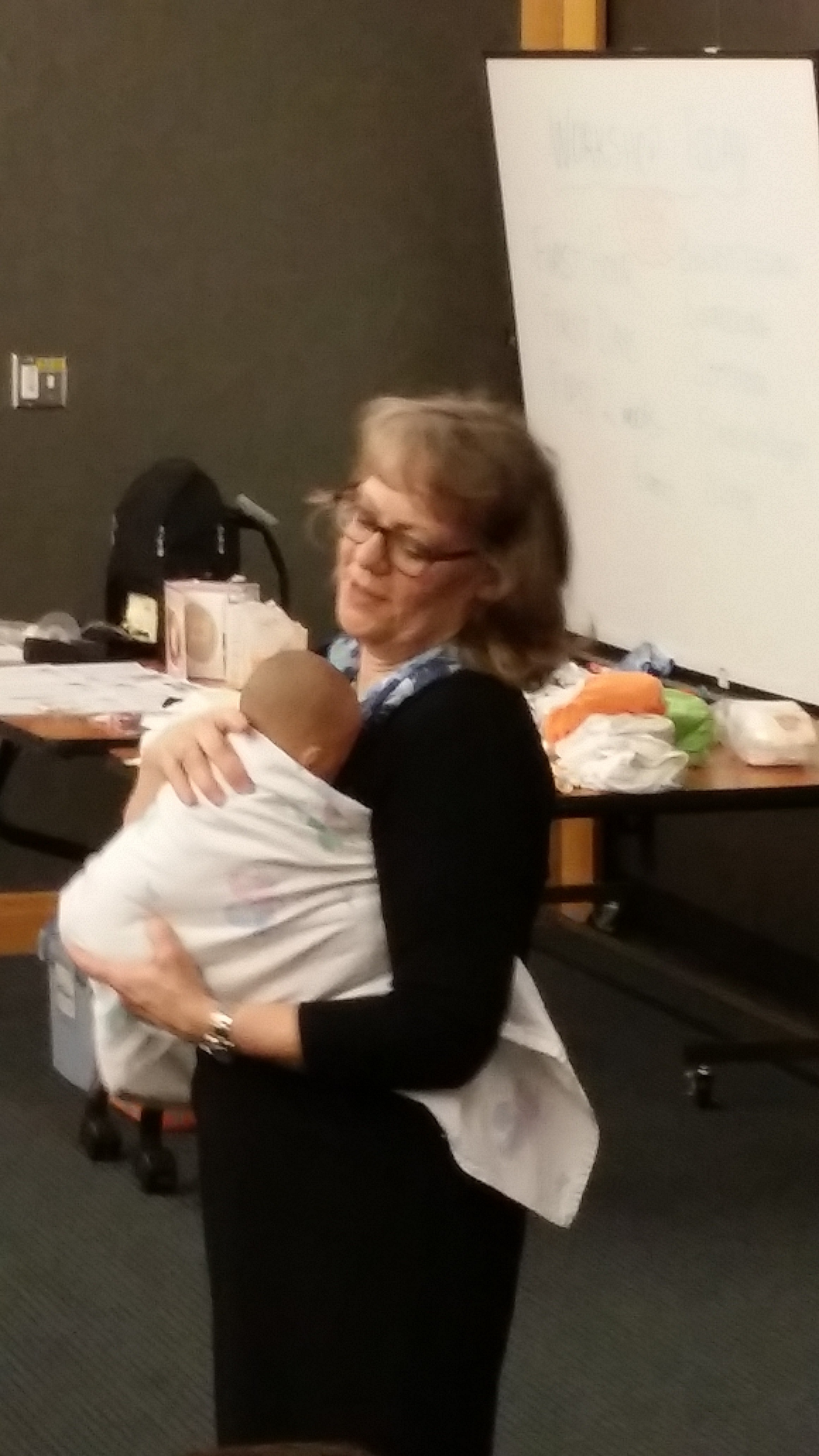 Alisa and I teach this technique in our breastfeeding and baby care seminar class. You can see how the blanket is really tucked under the arms and under baby's bum.
