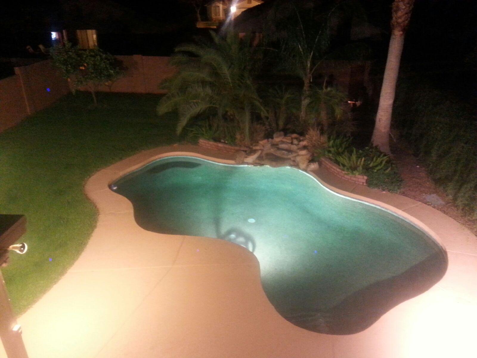Night lighting in an oasis pool