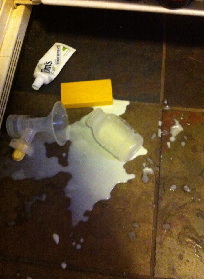 spilled breastmilk from mom storing milk in fridge
