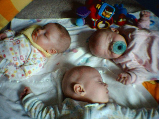Triplet babies so masterfully parented that they synced their schedules to fall asleep on play mat simultaneously.