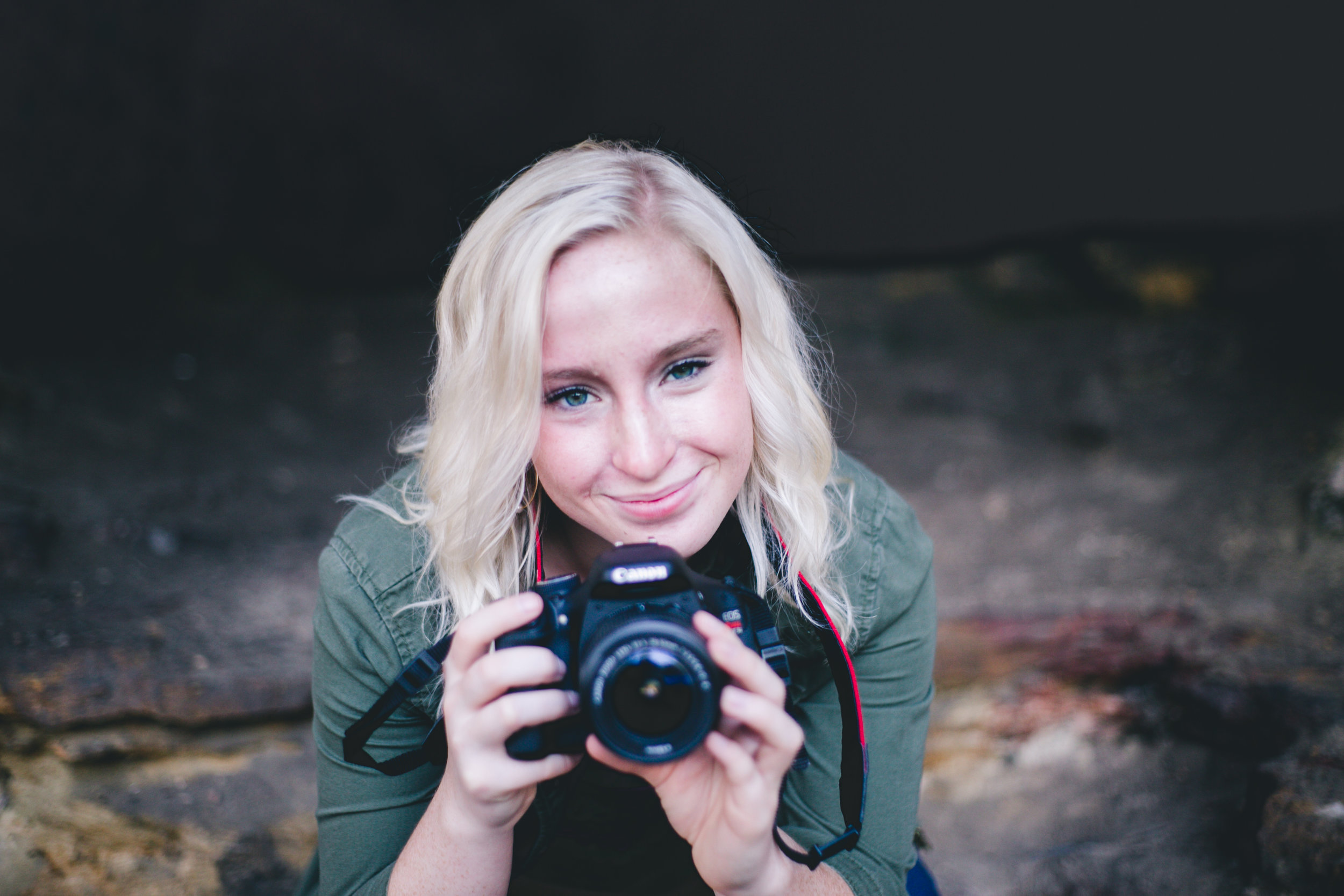 Blonde holds a Canon camera