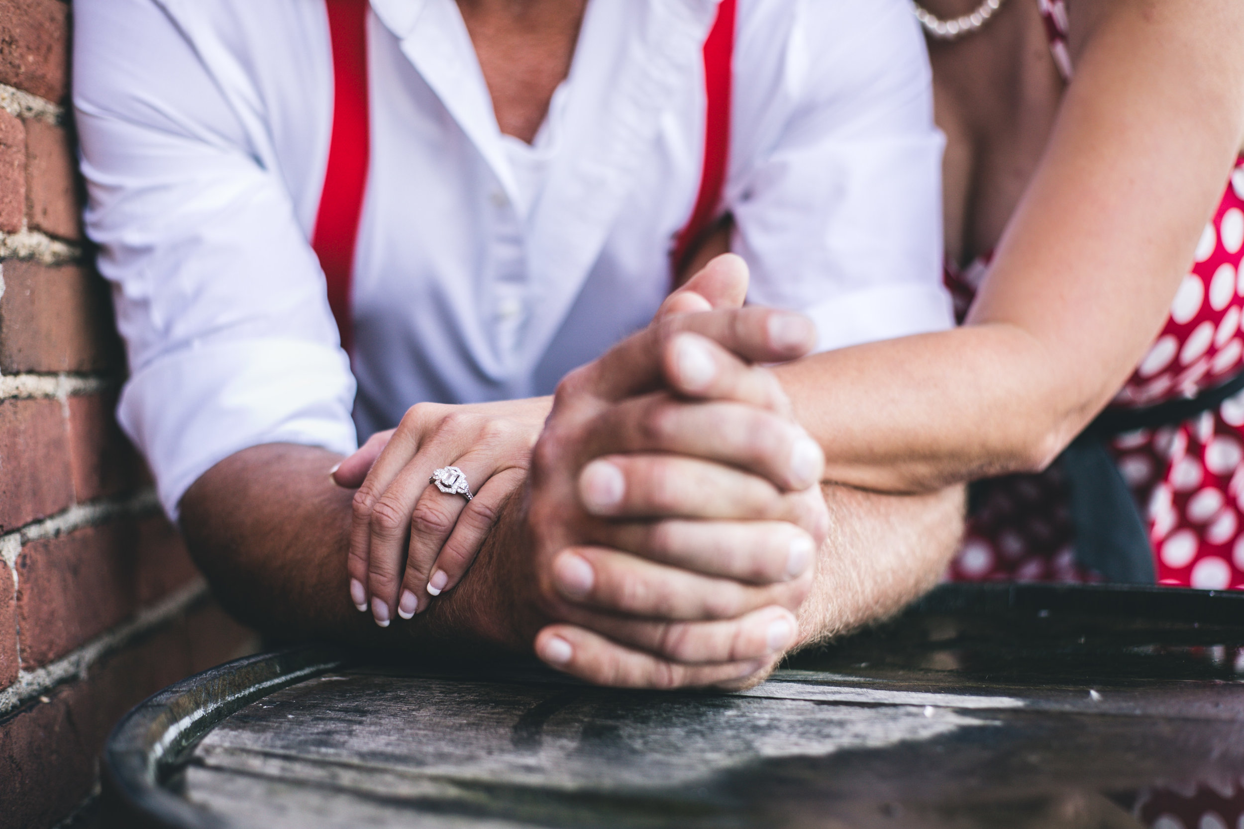 Couple holding hands engaged in Stillwater MN